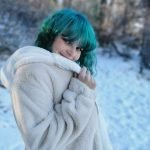 blue haired girl winter coat hippie on holiday founder